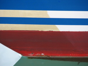 "Yacht hull ""yellowing"" untreated on left .. treated on right of photo."